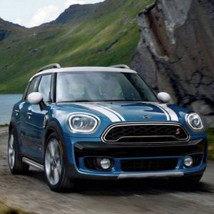 Blue Mini Driving on Road.jpg
