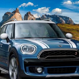 Blue Mini on road with Mountains.jpg